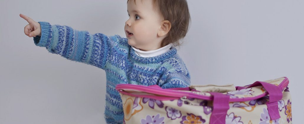 The baby playing with bag